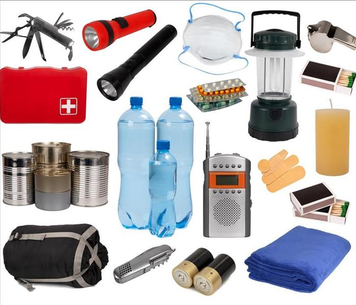 Flashlight, portable radio, batteries, water bottles and a first aid kit